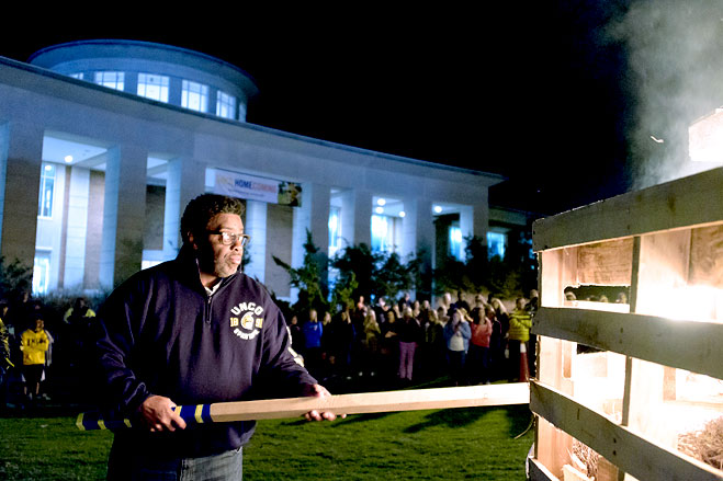 Chancellor Gilliam lights the Homecoming bonfire