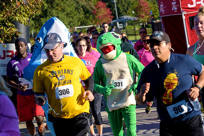 A view of runners, some in costume, participating in the Annual Homecoming 5K Run