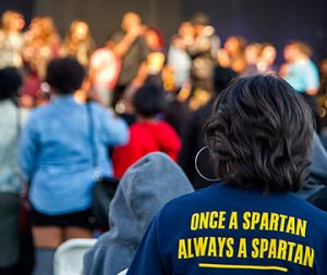 "Woman in crowd at Homecoming 2016, wearing a shirt reading ""Once a Spartan, Always a Spartan"""